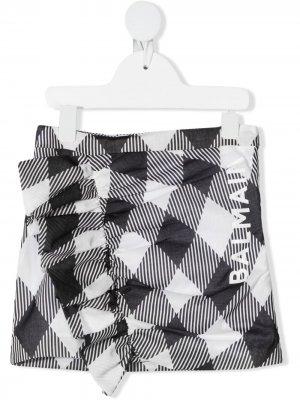 Присборенная клетчатая юбка с логотипом Balmain Kids. Цвет: черный