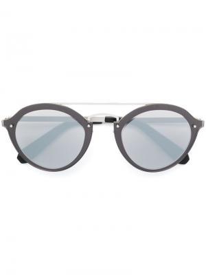 Солнцезащитные очки в круглой оправе Philipp Plein. Цвет: серебристый