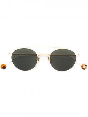 Солнцезащитные очки в круглой оправе Ahlem. Цвет: золотистый