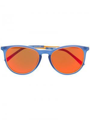 Солнцезащитные очки в круглой оправе Fila. Цвет: синий