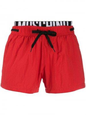Плавки-шорты с карманом Moschino. Цвет: красный