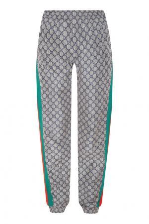 Спортивные брюки с лампасами и монограммами GG Gucci Man. Цвет: multicolor