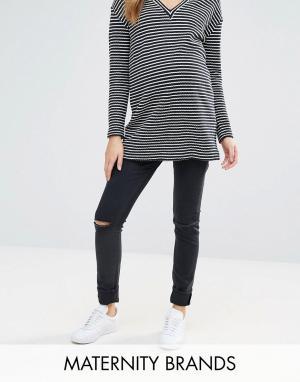 Эластичные джинсы скинни с рваными коленями Isabella Oliver. Цвет: черный