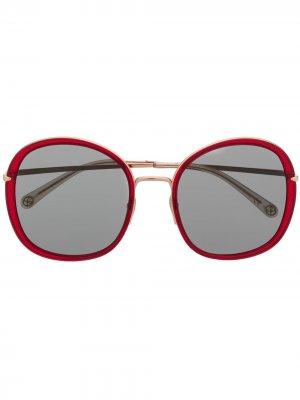 Солнцезащитные очки в круглой оправе Pomellato Eyewear. Цвет: красный