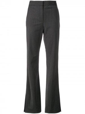 Расклешенные брюки в тонкую полоску Tibi. Цвет: серый