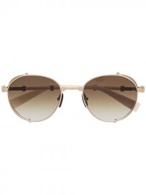 Солнцезащитные очки из коллаборации с Akoni Balmain Eyewear. Цвет: золотистый