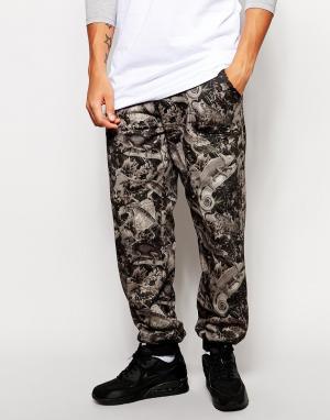 Спортивные штаны с принтом Iuter. Цвет: синий