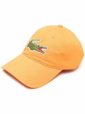 Бейсболка с вышитым логотипом Lacoste. Цвет: оранжевый