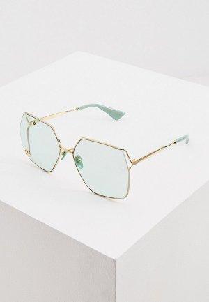 Очки солнцезащитные Gucci GG0817S. Цвет: золотой