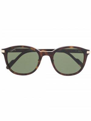 Солнцезащитные очки CT0302S в круглой оправе Cartier Eyewear. Цвет: коричневый