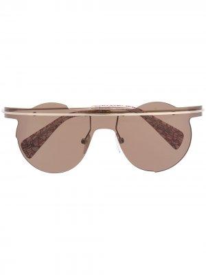 Солнцезащитные очки в металлической оправе Yohji Yamamoto. Цвет: золотистый