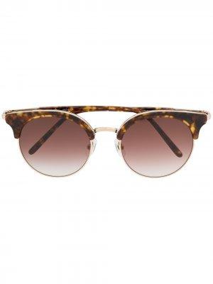 Солнцезащитные очки в круглой оправе Matsuda. Цвет: розовый