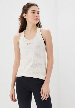 Майка спортивная Nike W NP TANK MTLC DOTS. Цвет: бежевый