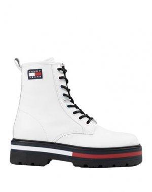 Полусапоги и высокие ботинки TOMMY JEANS. Цвет: белый