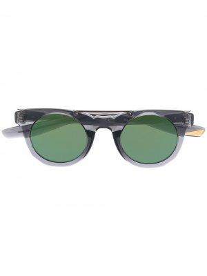 Солнцезащитные очки в круглой оправе Nike. Цвет: серый