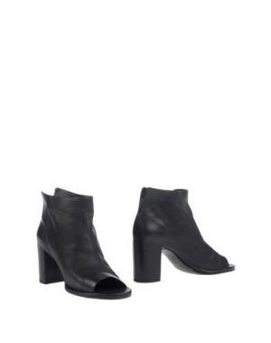 Полусапоги и высокие ботинки ROBERTO DEL CARLO. Цвет: черный