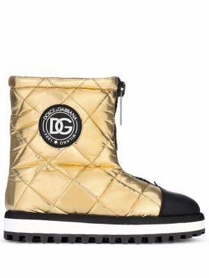Дутые ботинки с нашивкой-логотипом Dolce & Gabbana. Цвет: желтый