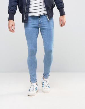 Голубые супероблегающие джинсы ASOS DESIGN. Цвет: синий