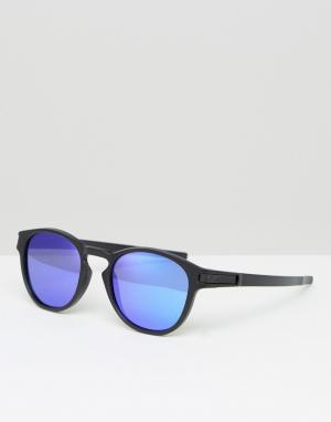 Солнцезащитные очки в круглой оправе с синими линзами Oakley. Цвет: черный