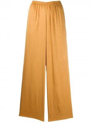 Укороченные спортивные брюки Forte. Цвет: золотистый