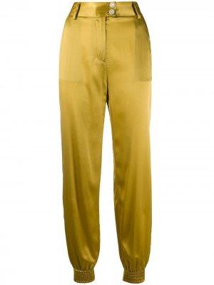 Зауженные брюки с гравировкой на пуговицах Just Cavalli. Цвет: золотистый