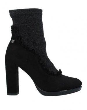 Полусапоги и высокие ботинки GIANMARCO VENTURI. Цвет: черный