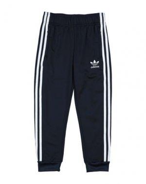 Повседневные брюки ADIDAS ORIGINALS. Цвет: темно-синий