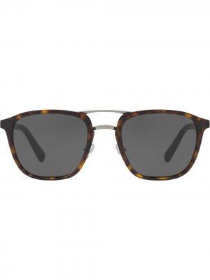 Солнцезащитные очки в круглой оправе Prada Eyewear. Цвет: коричневый