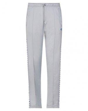 Повседневные брюки ARENA. Цвет: светло-серый