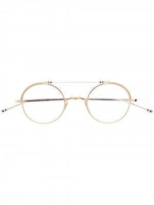 Очки в круглой оправе Thom Browne Eyewear. Цвет: золотистый