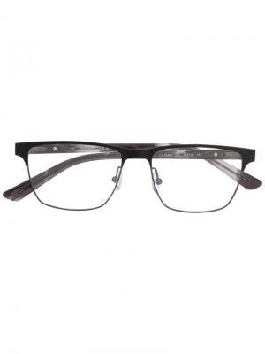 Очки в прямоугольной оправе Calvin Klein. Цвет: черный