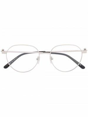Очки в круглой оправе с логотипом Balenciaga Eyewear. Цвет: серебристый