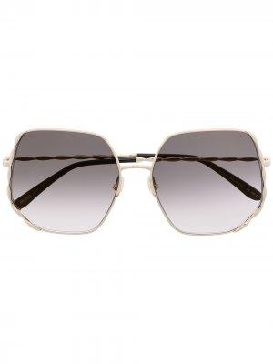 Солнцезащитные очки в шестиугольной оправе Elie Saab. Цвет: золотистый