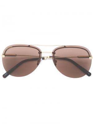 Солнцезащитные очки-авиаторы с затемненными линзами Bulgari. Цвет: металлический