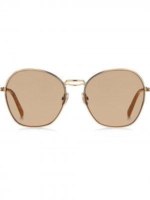 Солнцезащитные очки в круглой оправе Max Mara. Цвет: золотистый