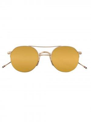 Солнцезащитные очки с круглой оправой Thom Browne Eyewear. Цвет: золотистый
