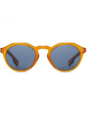Солнцезащитные очки в круглой оправе Burberry Eyewear. Цвет: оранжевый