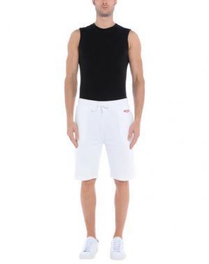 Пляжные брюки и шорты MOSCHINO. Цвет: белый