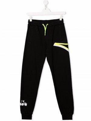 Спортивные брюки с логотипом Diadora Junior. Цвет: черный