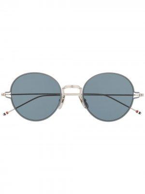 Солнцезащитные очки в круглой оправе Thom Browne Eyewear. Цвет: серебристый